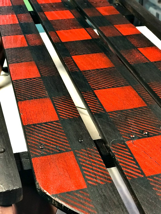 Close up of red buffalo check sled
