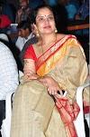 Beautiful Indian TV Actress Pragathi Aunty Stills In Yellow Saree