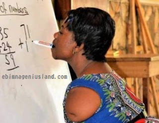Teacher Uses Her Mouth to Write On The White Board