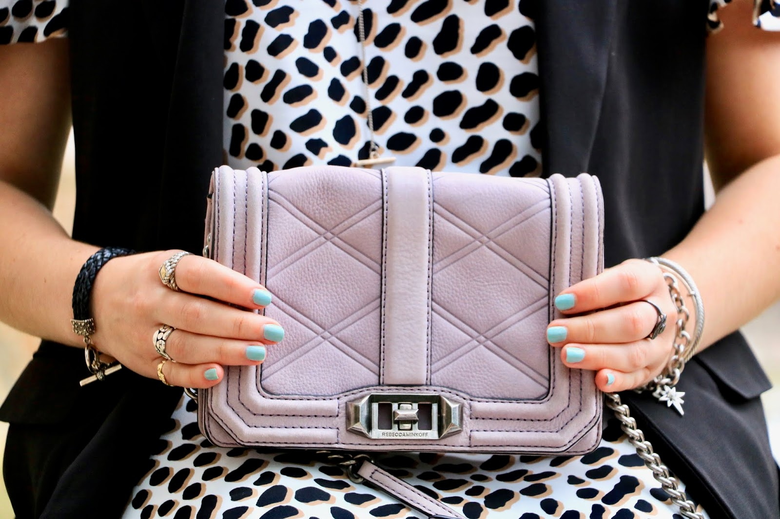 Nyc fashion blogger Kathleen Harper wearing a purple Rebecca Minkoff purse