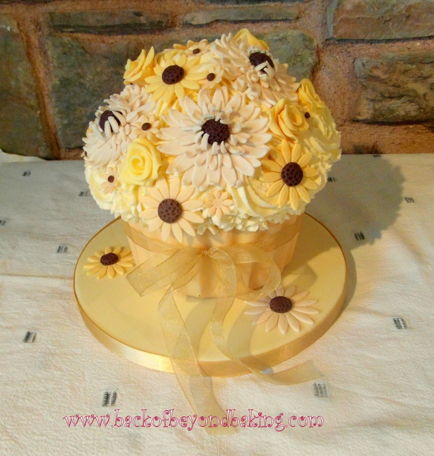 Cream and gold giant cupcake