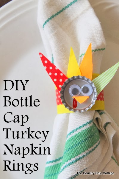 DIY Bottle Cap Turkey Napkin Rings -- make this craft for the kids table at Thanksgiving!  Made with bottle caps and paper towel rolls these are also the ultimate recycled craft!