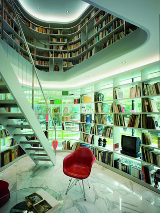 Amazing library and the staircase of The L House by Philippe Stuebi Architekten GMBH