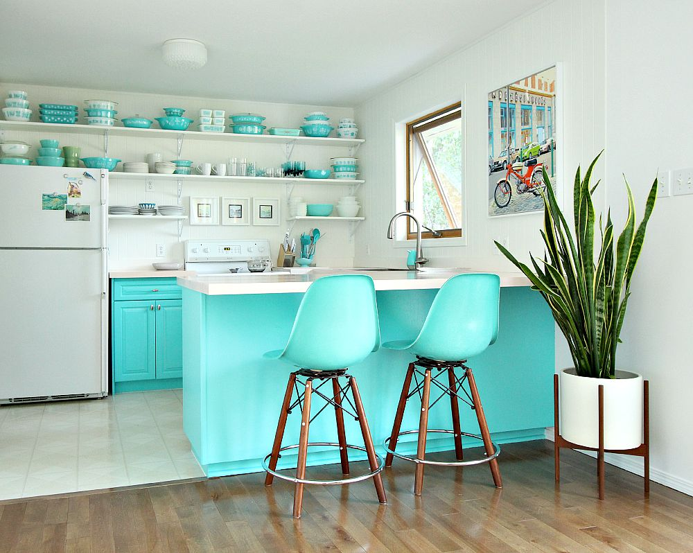 Aqua kitchen with Pyrex collection and Modernica side shell stools