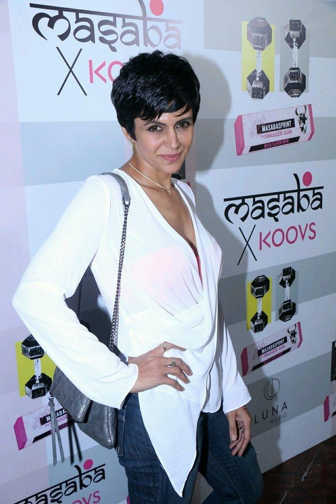 Indian Model Mandira Bedi Stills In White Shirt Jeans