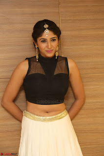 Roshni Prakash in a Sleeveless Crop Top and Long Cream Ethnic Skirt 075.JPG
