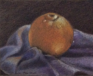 A still life painting of an orange using Derwent colour pencils