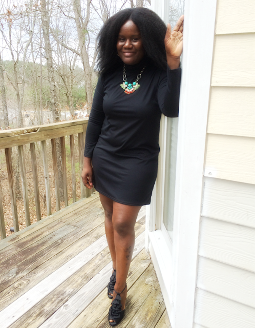 how to wear a simple black dress with a statement necklace