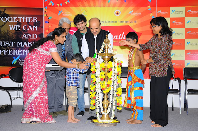 Mr. Krishna, Diganth, Dr. K. Bhujang Shetty, Mrs. Maya CHandra lighting lamp with Blind Children