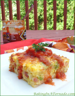 Tex-Mex Breakfast Casserole, shredded potatoes, onion, peppers and cheese baked into a fluffy breakfast casserole | Recipe developed by www.BakingInATornado.com | #recipe #breakfast