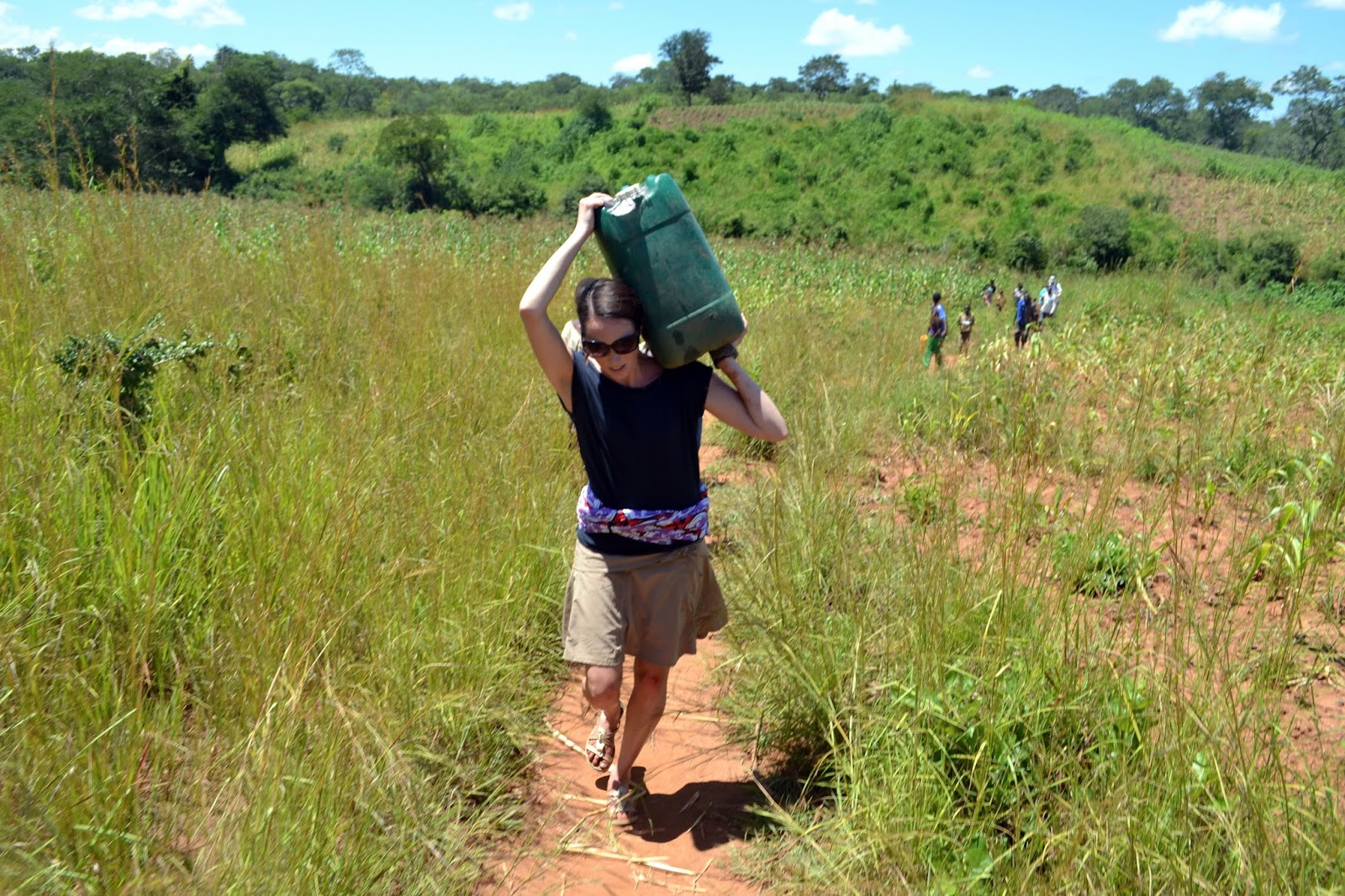 walking for water on the red dirt of africa
