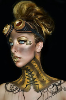 Steampunk makeup with gold body paint on neck and face, metal gears glued on and dirty goggle marks. fx mua