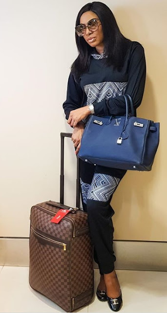 chika ike Louis Vuitton luggage
