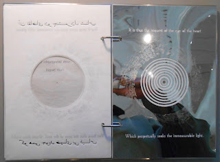 Two-page spread of Fragments of Light showing mylar reflection