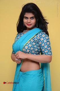 Telugu Actress Alekhya Stills in Green Saree at Swachh Hyderabad Cricket Press Meet  0056.JPG