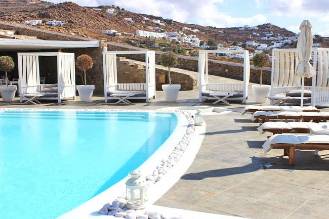 Rocabella Hotel pool and white lounge space