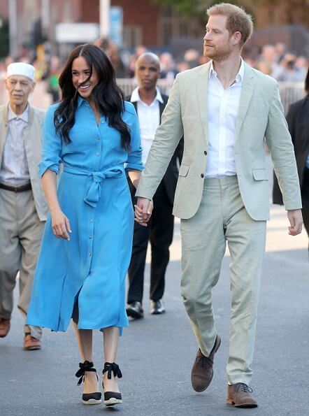 Meghan Markle wore Veronica Beard Sky Blue Cara dress. Duchess is in the same dress she wore on tour in Tonga