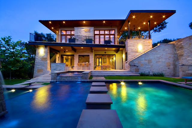 Picture of an amazing modern luxury house as seen from the pool in front of the house