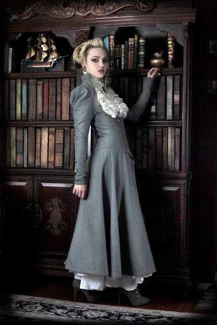Woman in Gray Steampunk or steamgoth long gothic victorian coat. Women's steampunk fashion.