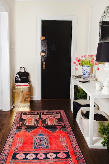 Eclectic entryway designed with vintage rug