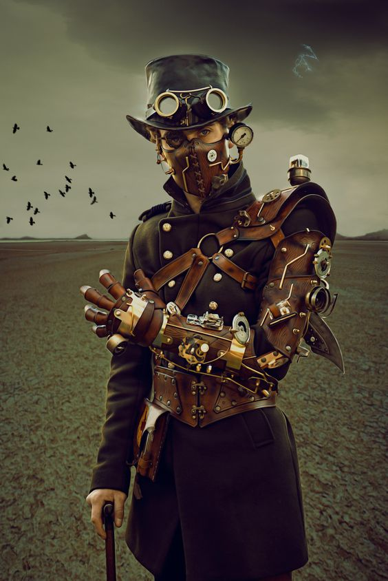 Men's steampunk cosplay. Top hat, goggles, leather harness, mechanical arm, coat, trousers, cane, leather mask.