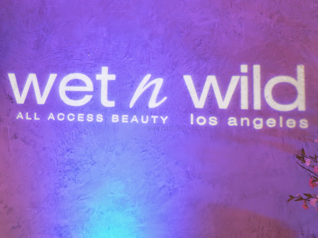 Wet n wild in white text on a purple background
