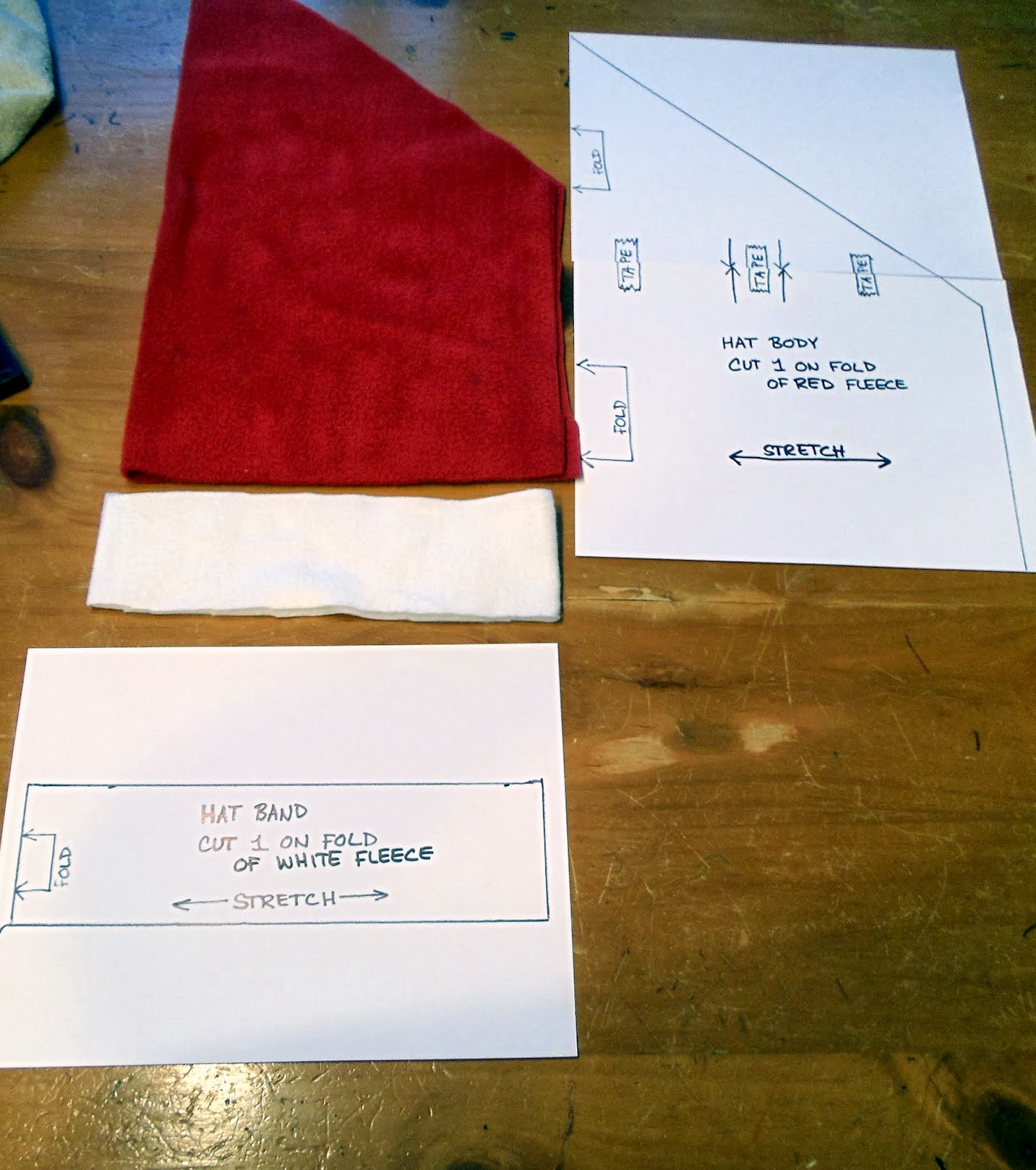 ... arrow of the pattern on the fabric fold. Do the same for the hat band  on the white fleece ff3e48c2b4d