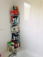 Tesa corner no screw bathroom shelfs.