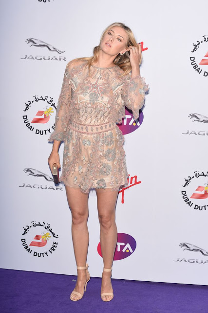 Maria Sharapova stunning leggy poses at WTA party carpet photo 10