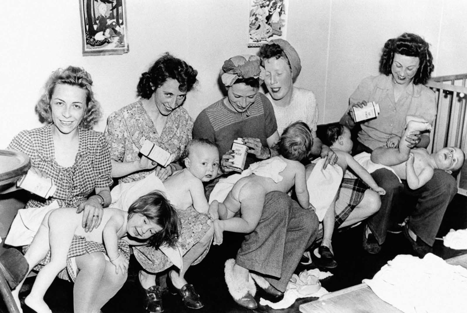 New mothers change their babies' diapers in New York City, 1946.