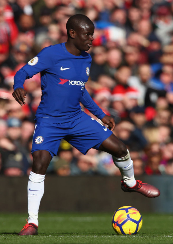Chelsea's N'Golo Kante slumps in front of Teammates