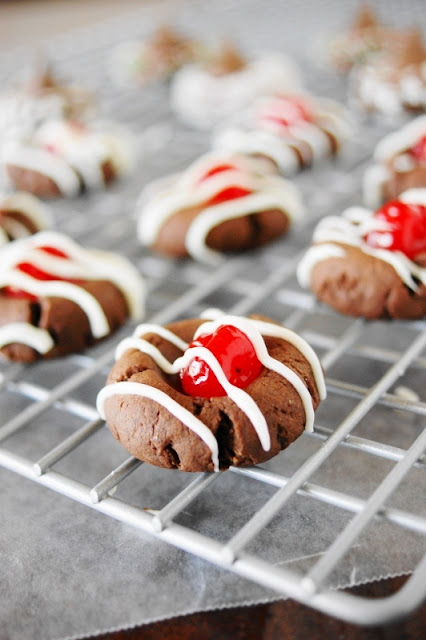 Cherry Chocolate Thumbprint Cookies ~ cute little cookies inspired by the flavors of classic chocolate covered cherries. Perfect for Christmas, Valentine's Day, or ANY day!  www.thekitchenismyplayground.com