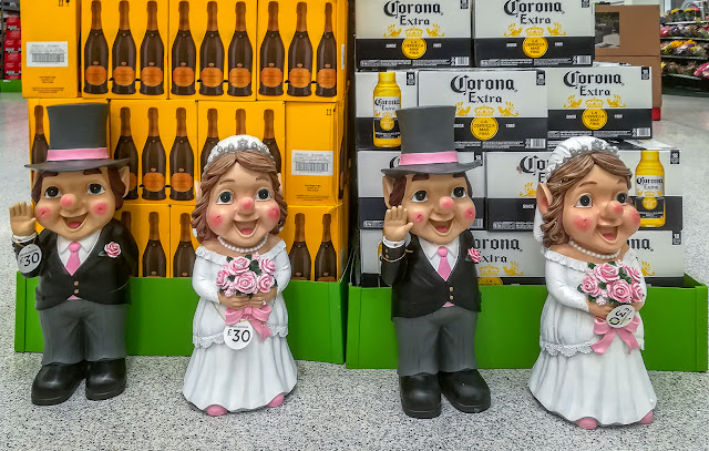 Photo of bridge and groom garden gnomes in a local supermarket