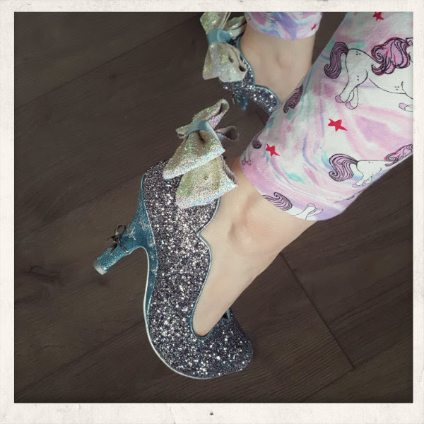 wearing irregular choice sparkling slipper bow detail