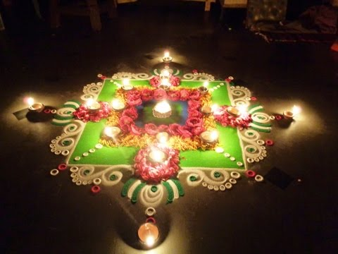 diwali special best, latest rangoli design with lamps deepam on street