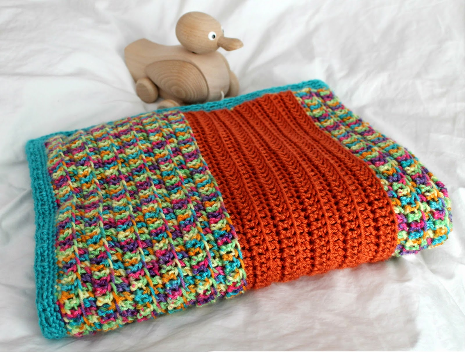 Create a Broad-Stripe Baby Blanket great for a boy or a girl with this easy, unisex crochet pattern at The Inspired Wren.