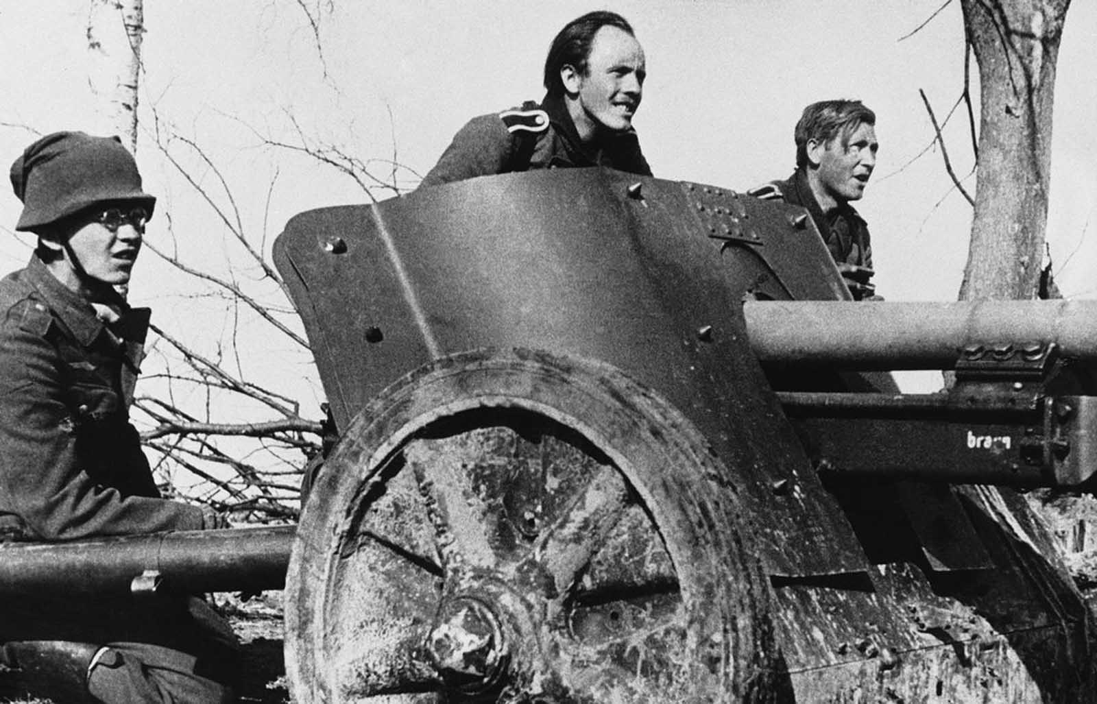 The crew of a German anti-tank gun, ready for action at the Russian front in late 1942.