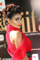 Apoorva in a Stunning Tight Leg Split Sleeveless Red Gown at IIFA Utsavam Awards 002.JPG