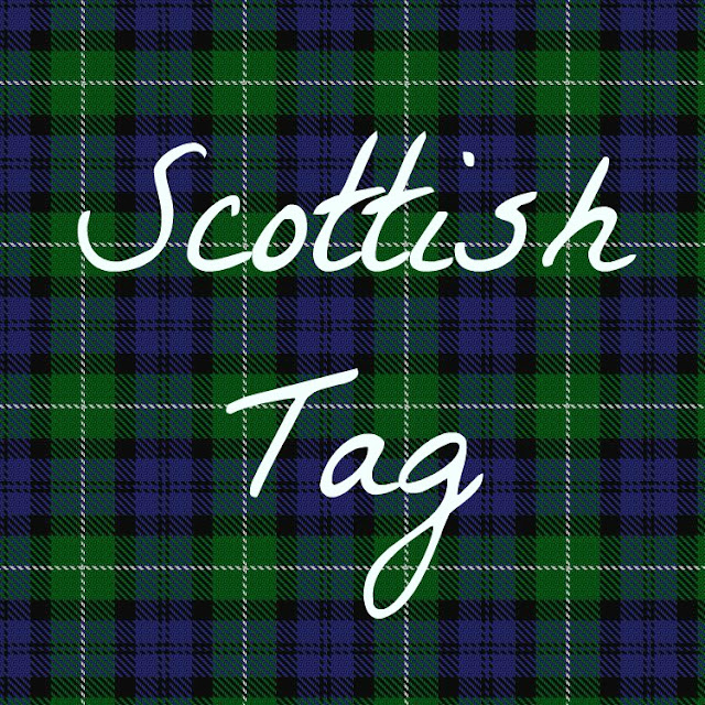 "Blue and green Campbell tartan background with white text reading ""Scottish tag"""