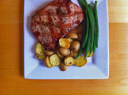 Boneless grilled chop with Tasteful Selections, One Bite potatoes and French Green Beans