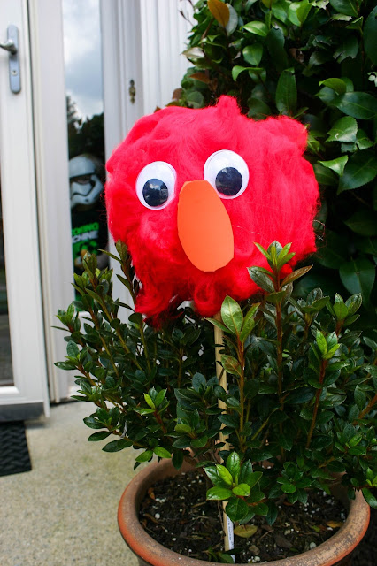 Elmo Birthday Party - Elmo head decoration made with red fiber and a styrofoam ball