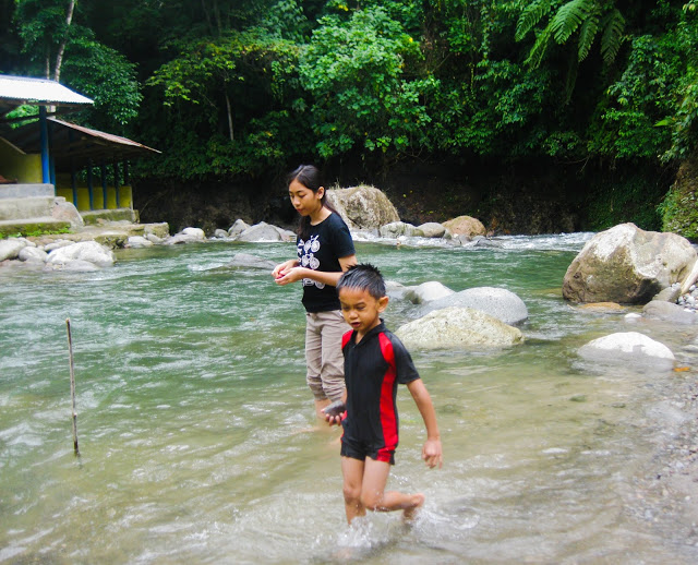 Playing with the fresh water in the river is the most preferred activity is local travelers