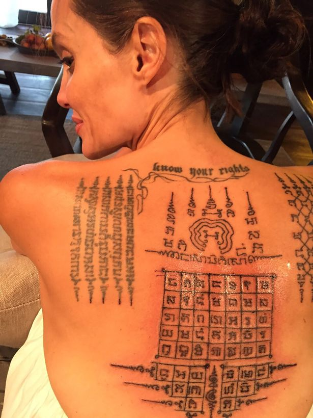 PAY-SUNDAY-MIRROR-PROD-Angelina-Jolie-gets-magical-tattoos-in-Thailand (1).jpg