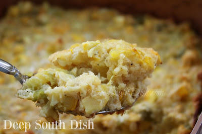 A cornbread dressing made with yellow squash, sauteed with onion, celery and bell pepper.
