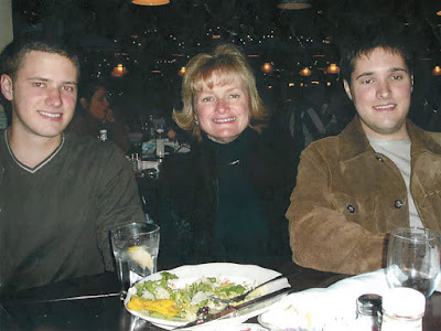 Bart Whitaker, right, is pictured with his mother, Trisha, and brother, Kevin, at his graduation celebration dinner in December 2003.