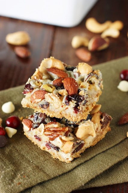 Mixed Nuts & Cranberry Magic Bars ~ perfect for celebrating the holiday season ... or a random Tuesday! Enjoy for snacks, parties, cookie trays, and holiday gift-giving, too.   www.thekitchenismyplayground.com