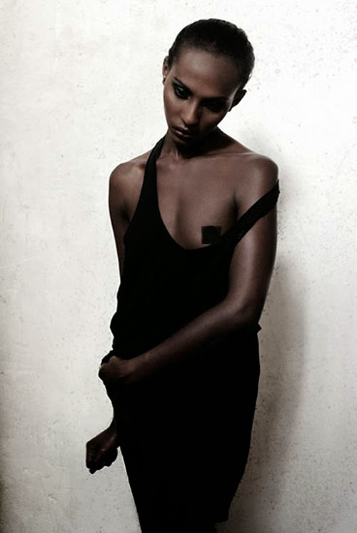 modeling portfolio by fashion photographer gilbert rossi, black model on white background, studio beauty study