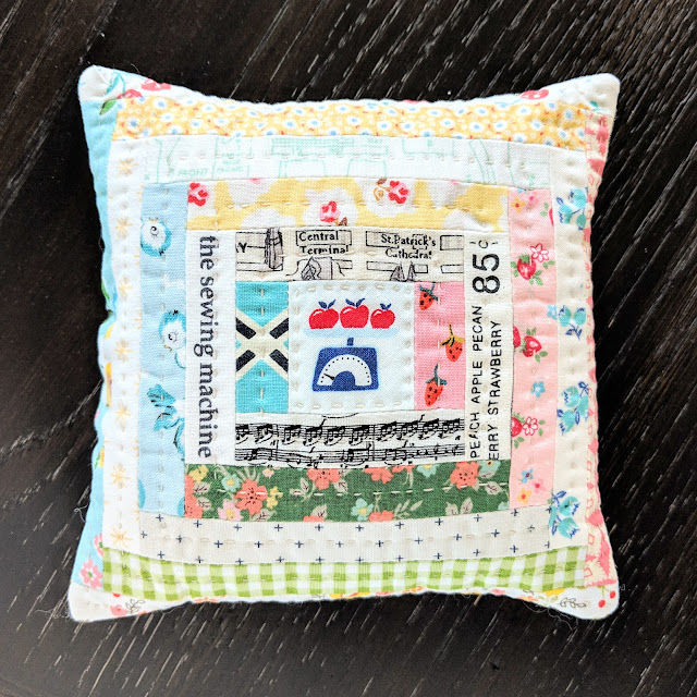 Scrappy Log Cabin Pillow by Heidi Staples of Fabric Mutt