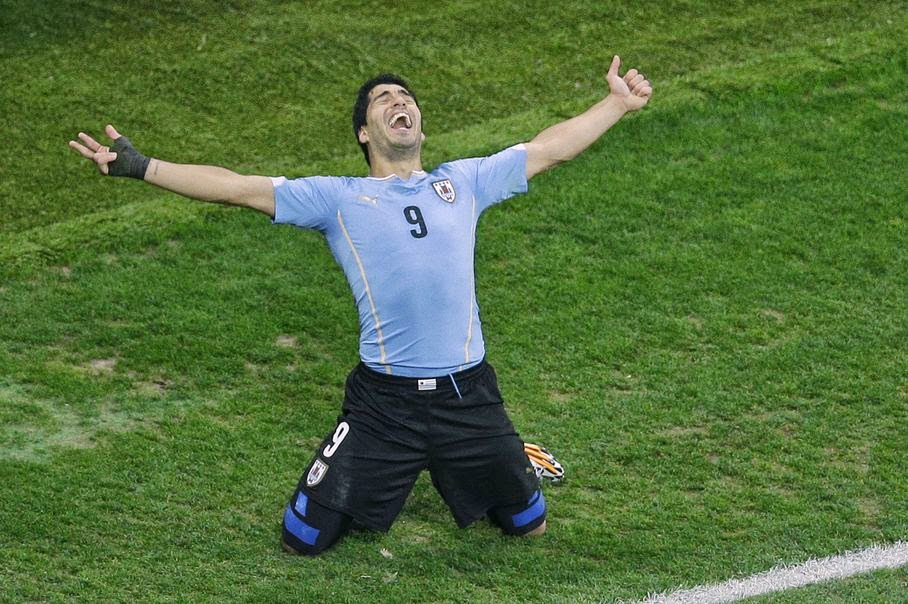 Uruguay's Luis Suarez celebrates scoring 2-1 during the group D World Cup soccer match between Uruguay and England at the Itaquerao Stadium in Sao Paulo, Brazil, Thursday, June 19, 2014.