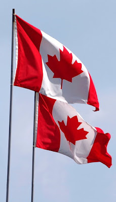 Two red and white Canadian flags with central maple leaf.